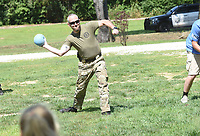 COPS AND KIDS SUMMER FUN<br />Sgt. Stephen Deppner with the Benton County Sheriff's Office cuts loose with a throw during a dodge ball game on Tuesday July 13 2021 at the Cops and Kids Summer Games held at the Benton County Sheriff's Office in Bentonville. Deputies and staff hosted dozens of youngsters age 10-12 at the one-day summer games held outside the sherriff's office. Kids enjoyed an array of games and activities under the direction of the Benton County Police Athletic League. The athletic league aims to keep young people out of trouble by channeling their energy into recreational and athletic programs. Go to nwaonline.com/210714Daily/ to see more photos.<br />(NWA Democrat-Gazette/Flip Putthoff)