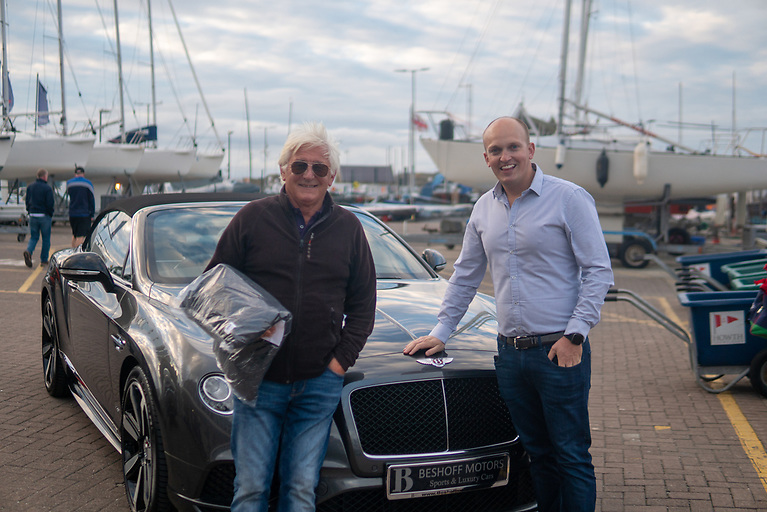 Suits you sir! Demelza's Windsor Laudan with the latest of his many winner jackets, and Jeremy Beshoff of Beshoff Motors with a rather elegant Bentley coupe. Photo: Annraoi Blaney