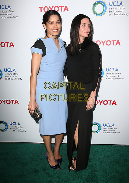BEVERLY HILLS, CA - March 13: Freida Pinto, Courteney Cox, At The UCLA Institute Of The Environment And Sustainability Celebrates Innovators For A Healthy Planet At Private Resident In California on March 13, 2017. <br /> CAP/MPI/FS<br /> ©FS/MPI/Capital Pictures