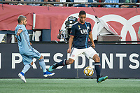 FOXBOROUGH, MA - SEPTEMBER 29: Maximiliano Moralez #10 of New York City FC comes in to tackle Brandon Bye #15 of New England Revolution during a game between New York City FC and New England Revolution at Gillettes Stadium on September 29, 2019 in Foxborough, Massachusetts.