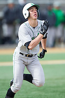 Corey Bird (31) of the Marshall Thundering Herd hustles down the first base line against the Wake Forest Demon Deacons at Wake Forest Baseball Park on February 17, 2014 in Winston-Salem, North Carolina.  The Demon Deacons defeated the Thundering Herd 4-3.  (Brian Westerholt/Four Seam Images)