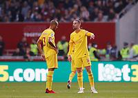 25th September 2021; Brentford Community Stadium, London, England; Premier League Football Brentford versus Liverpool; Jordan Henderson of Liverpool talking to Fabinho of Liverpool