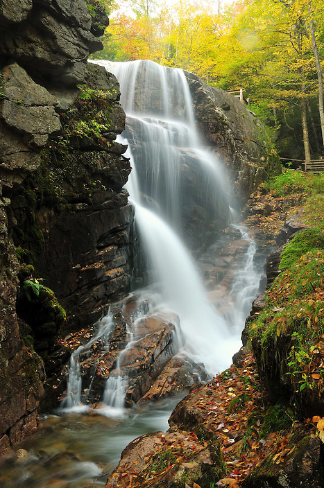 Part of the Flume Gorge experience in Franconia Notch State Park, Avalanche Falls. On hot summer days this waterfall is  pretty to look at, and the cooling mist makes it a pleasure to stand near.