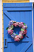 Floral wreath on country door.