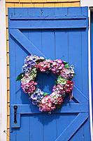 Floral wreath on country door.