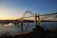 Yaquina Bay Bridge at sunset, Oregon, reflecting gold light
