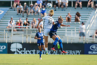 CARY, NC - SEPTEMBER 12: Lindsey Horan #10 of the Portland Thorns wins a header against Merritt Mathias #11 of the NC Courage during a game between Portland Thorns FC and North Carolina Courage at WakeMed Soccer Park on September 12, 2021 in Cary, North Carolina.
