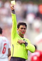 Referee Shamsul Maidin issues a yellow card. Poland defeated Costa Rica 2-1 in their FIFA World Cup Group A match at FIFA World Cup Stadium, Hanover, Germany, June 20, 2006.