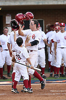 Max White of the Oklahoma Sooners is greeted at home plate after homering in Game Two of the NCAA Super Regional tournament against the Virginia Cavaliers at Charlottesville, VA - 06/13/2010. Oklahoma defeated Virginia, 10-7, to tie the series after two games.  Photo By Bill Mitchell / Four Seam Images