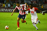 BARRANQUIILLA - COLOMBIA, 29-11-2018:James Sanchez   (Izq.) de Junior disputa el balón con Hernan Burbano (Der.) del Santa Fe durante el encuentro entre Atlético Junior de Colombia e Independiente Santa Fe de Colombia por la semifinal, vuelta, de la Copa CONMEBOL Sudamericana 2018 jugado en el estadio Roberto Meléndez de la ciudad de Barranquilla. /James Sanchez (L) of Junior struggles for the ball with HernanBurbano (R) of Santa Fe during a semifinal second leg match between Atletico Junior of Colombia and Independiente Santa Fe of Colombia as a part of Copa CONMEBOL Sudamericana 2018 played at Roberto Melendez stadium in Barranquilla city Atletico Junior de Colombia e Independiente Santa Fe de Colombia en partido por la semifinal, vuelta, de la Copa CONMEBOL Sudamericana 2018 jugado en el estadio Roberto Meléndez de la ciudad de Barranquilla. / Atletico Junior of Colombia and Independiente Santa Fe of Colombia in Semifinal second leg match as a part of Copa CONMEBOL Sudamericana 2018 played at Roberto Melendez stadium in Barranquilla city.  Photo: VizzorImage/ Alfonso Cervantes / Cont