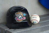 Biloxi Shuckers helmet and Southern League baseball in the dugout before the second game of a double header against the Pensacola Blue Wahoos on April 26, 2015 at Pensacola Bayfront Stadium in Pensacola, Florida.  Biloxi defeated Pensacola 2-1.  (Mike Janes/Four Seam Images)
