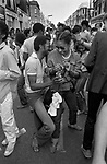 Notting Hill Carnival group of black couple  celebrating partying, having fun dancing the Bump dance into the night. 1980s  UK