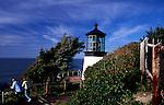 Famous lighthouse on Cape Mears, near Tillamook, OR., couple watches ocean.