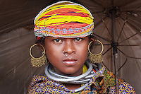Bonda tribe young girl wearing thick silver necklace bands