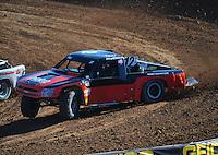 Dec. 9, 2011; Chandler, AZ, USA;  LOORRS pro 4 unlimited driver Myan Spaccarelli during qualifying for round 15 at Firebird International Raceway. Mandatory Credit: Mark J. Rebilas-
