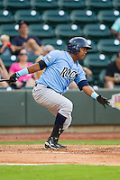 Daniel Mateo (16) of the Wilmington Blue Rocks follows through on his swing against the Winston-Salem Dash at BB&T Ballpark on August 3, 2013 in Winston-Salem, North Carolina.  The Blue Rocks defeated the Dash 4-2.  (Brian Westerholt/Four Seam Images)