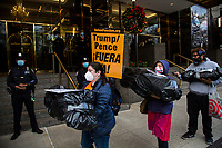 NEW YORK, UNITED STATES - NOVEMBER 21: Activists walk with black bags alongside Trump International Hotel & Tower on November 21, 2020 in New York City. Some people gather in Columbus Circle to protest against the government of President Donald Trump, with a symbolic act where they use black bags as if they were corpses due to the thousands of deaths produced by Covid-19. Photo by Pablo Monsalve / VIEWpress via Getty Images)