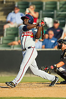 Felix Marte (28) of the Rome Braves follows through on his swing against the Kannapolis Intimidators at CMC-Northeast Stadium on August 25, 2013 in Kannapolis, North Carolina.  The Intimidators defeated the Braves 9-0.  (Brian Westerholt/Four Seam Images)