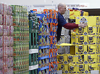 Charles Strand straightens inventory at a Costco Wholesale Warehouse Friday, March 9, 2007 in Columbus, Ohio.