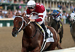 LOUISVILLE, KY -JUNE 18: Gun Runner (Candy Ride x Quiet Giant, by Giant's Causeway, ridden by Florent Geroux) wins the 19th running of the G3 Matt Winn at Churchill Downs, Louisville, Kentucky. He is owned by Winchell Thoroughbreds LLC (Ron Winchell), Three Chimneys Farm LLC (Zuleika B. Torrealba), and Besilu Stables (Ben Leon Jr.) and trained by Steven M. Asmussen. (Photo by Mary M. Meek/Eclipse Sportswire/Getty Images)