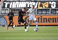 LOS ANGELES, CA - APRIL 17: Ben Sweat #22 of Austin FC battles with Corey Baird #13 of LAFC during a game between Austin FC and Los Angeles FC at Banc of California Stadium on April 17, 2021 in Los Angeles, California.