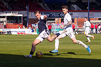 24th April 2021; Dens Park, Dundee, Scotland; Scottish Championship Football, Dundee FC versus Raith Rovers; Jason Cummings of Dundee goes past Brad Spencer of Raith Rovers