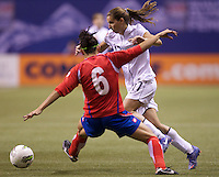 Tobin Heath, right, of the United States gets past Carol Sanchez of Costa Rica during play in the CONCACAF Olympic Qualifying semifinal match at BC Place in Vancouver, B.C., Canada Friday Jan. 27, 2012. The United States won the match 3-0 to earn a berth in 2012 London Olympics.