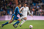 Danilo Luiz Da Silva (r) of Real Madrid battles for the ball with Theo Bongonda Mbul'ofeko Batombo of RC Celta de Vigo during their Copa del Rey 2016-17 Quarter-final match between Real Madrid and Celta de Vigo at the Santiago Bernabéu Stadium on 18 January 2017 in Madrid, Spain. Photo by Diego Gonzalez Souto / Power Sport Images