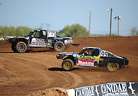 Apr 15, 2011; Surprise, AZ USA; LOORRS driver Steve Barlow (83) leads Kyle Leduc (99) during round 3 and 4 at Speedworld Off Road Park. Mandatory Credit: Mark J. Rebilas-.