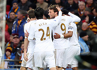 Pictured: Michu of Swansea (2nd R) mobbed by team mates celebrating his goal. Sunday 24 February 2013<br /> Re: Capital One Cup football final, Swansea v Bradford at the Wembley Stadium in London.