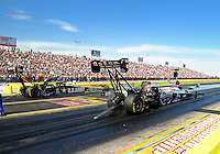 Sept. 24, 2011; Ennis, TX, USA: NHRA top fuel dragster driver Larry Dixon (near lane) races alongside Tony Schumacher during qualifying for the Fall Nationals at the Texas Motorplex. Mandatory Credit: Mark J. Rebilas-