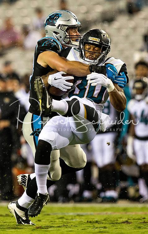Photography of the Carolina Panthers vs The Jacksonville Jaguars during their NFL preseason game at EverBank Stadium in Jacksonville, Florida.<br /> <br /> Charlotte Photographer - PatrickSchneiderPhoto.com