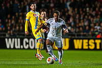 Swansea, UK. Thursday 20 February 2014<br /> Pictured: Wayne Routledgeof Swansea City ( with ball ) makes his way towards the Napoli Goal <br /> Re: UEFA Europa League, Swansea City FC v SSC Napoli at the Liberty Stadium, south Wales, UK