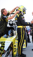 Sept. 2, 2011; Claremont, IN, USA: A crew member helps NHRA top fuel dragster driver Morgan Lucas during qualifying for the US Nationals at Lucas Oil Raceway. Mandatory Credit: Mark J. Rebilas-