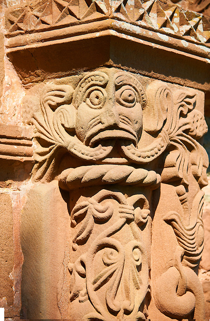 Norman Romanesque relief sculptures of a Green Man with decorative columns from the South doorway of Church of St Mary and St David, Kilpeck Herifordshire, England. Built around 1140.