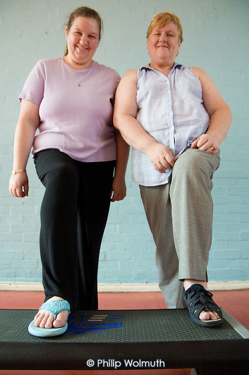 Mother and daughter Noreen and Rachel Parker on an exercise step at a healthy living session at Westbourne Park Family Centre
