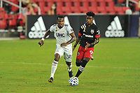 WASHINGTON, DC - SEPTEMBER 27: Oniel Fisher #91 of D.C. United battles for the ball with Cristian Penilla #70 of New England Revolution during a game between New England Revolution and D.C. United at Audi Field on September 27, 2020 in Washington, DC.