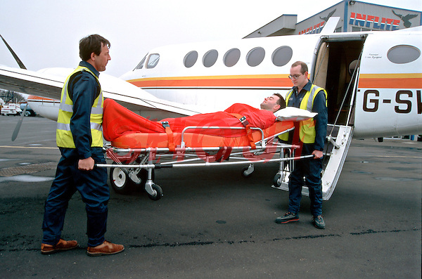 Casualty on stretcher being unloaded off an air ambulance by paramedics, before being put into an awaiting road ambulance...© SHOUT. THIS PICTURE MUST ONLY BE USED TO ILLUSTRATE THE EMERGENCY SERVICES IN A POSITIVE MANNER. CONTACT JOHN CALLAN. Exact date unknown.john@shoutpictures.com.www.shoutpictures.com.....