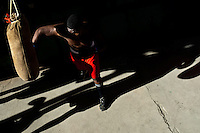 A Cuban boxer trains punching at Rafael Trejo boxing gym, an outdoor sport facility in the Old Havana, Cuba, 5 February 2010. During the last 30 years Cuba has produced more World Champions and Olympic gold medallists in amateur boxing than any other country. Many famous fighters, who came out of Cuba, were training at Rafael Trejo boxing gym in their youth. This run down open air facility in the Old Havana is a place of learning and mastering the art of boxing by the old school style. Boys begin their training very young. As sports are given a high political priority in Cuba, all children are systematically encouraged to develop their skills. Those who succeed will become heroes of Cuban society.