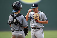 Pitcher Nate Harris (14) of the Asheville Tourists talks with catcher Austin Bernard in a game against the Greenville Drive on Sunday, June 3, 2018, at Fluor Field at the West End in Greenville, South Carolina. Greenville won, 7-6. (Tom Priddy/Four Seam Images)