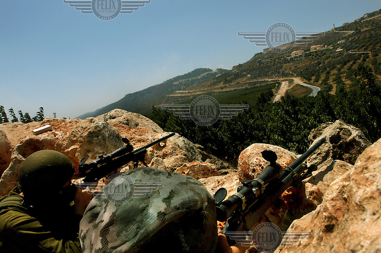 Israeli snipers provide cover for a rescue operation of wounded soldiers near the Lebanese village of Kafar Kila. Israel launched attacks on Lebanon in retaliation for the capture of two of its soldiers by Hezbollah (Hizbollah) militants.