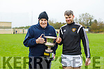 Kilmoyley captain John B O'Halloran accepts the cup from Joe Walsh of the North Kerry Hurling Board having defeated Causeway in the North Kerry Senior Hurling Championship final