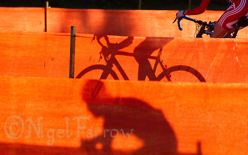 03 NOV 2012 - IPSWICH, GBR - A competitor makes her way through a zig-zag section of the course marked with orange scrim during the Elite Women's European Cyclo-Cross Championships in Chantry Park, Ipswich, Suffolk, Great Britain .(PHOTO (C) 2012 NIGEL FARROW)