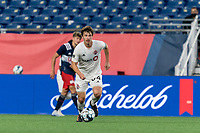 FOXBOROUGH, MA - JULY 23: Kevin Politz #64 of Toronto FC II brings the ball forward during a game between Toronto FC II and New England Revolution II at Gillette Stadium on July 23, 2021 in Foxborough, Massachusetts.