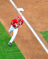 24 April 2010: Washington Nationals' pitcher Craig Stammen rounds third and comes home to score but the run did not count as Nyjer Morgan was called out at third base a moment before Stammen crossed the plate resulting the the 3rd out by the Los Angeles Dodgers at Nationals Park in Washington, DC. The Dodgers edged out the Nationals 4-3 in a thirteen inning game. Mandatory Credit: Ed Wolfstein Photo