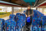 Denis Doran, who works with Fitzpatrick's of Listowel pictured sanitising the buses.
