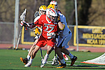 Baltimore, MD - March 3:  Attackmen Tristan Sperry #27 of the Fairfield Stags fights to the goal during the Fairfield v UMBC mens lacrosse game at UMBC Stadium on March 3, 2012 in Baltimore, MD.