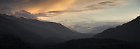 Moody sunset at Cascades with Red Hills in distance and Olivine Ranges on left, West Coast, South Westland, UNESCO World Heritage Area, New Zealand, NZ