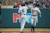 Wander Franco (6) of the Princeton Rays is greeted at home plate by teammate Jake Palomaki (1) after hitting a 2-run home run against the Pulaski Yankees at Calfee Park on July 14, 2018 in Pulaski, Virginia. The Rays defeated the Yankees 13-1.  (Brian Westerholt/Four Seam Images)