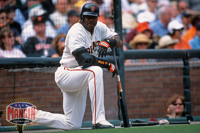 SAN FRANCISCO, CA:  Barry Bonds of the San Francisco Giants kneels in the on deck circle during a game at Pacific Bell Park in San Francisco, California in 2001. (Photo by Brad Mangin)